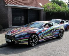 jeff koons aston martin - Artist Jeff Koons has been putting his creative talents into luxury cars. First, he designed for BMW's Art Car and now the limited edition Jeff Koo. Aston Martin Dbs, James Bond Cars, Car Tags, Jeff Koons, Carbon Black, Expensive Cars, Car Wrap, Bmw Cars, Car Detailing
