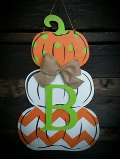 "Stacked pumpkins made of grade ""A"" plywood. A nice piece personalized for the Fall holidays. Halloween Door Hangers, Fall Door Hangers, Wooden Door Signs, Wooden Decor, Fall Crafts, Halloween Crafts, Pumpkin Ornament, Wood Yard Art, Wooden Pumpkins"