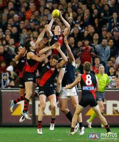 """Jake Carlisle flies high to mark during the 2013 AFL Round 11 match between the Essendon Bombers and the Carlton Blues at the MCG, Melbourne on June 07, 2013. (Photo: Andrew White/AFL Media)"""