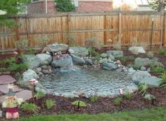 Small garden pond small garden fish ponds backyard ponds for garden fish pond designs images design Small Backyard Ponds, Ponds For Small Gardens, Backyard Water Feature, Small Ponds, Garden Ponds, Koi Ponds, Gravel Garden, Water Gardens, Small Water Features