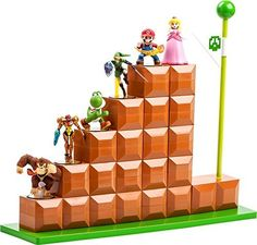 POWER A amiibo End Level Display by BD&A - Show that you are a true Nintendo fan with this big, 8-bit style amiibo figure display. Built of 22 kowarenai blocks this officially licensed stand holds up to six amiibo figures and measures over 15 inches tall and 18 inches wide. It comes complete with a green goal pole and a base. Made from custom molded, interlocking plastic parts this display stand works with all amiibo figures.