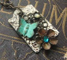 necklace pendant found object repurposed escutcheon on etsy by lilruby.  $38