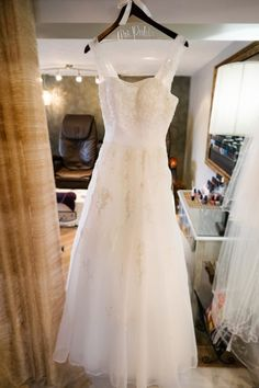 Beaded Empire Waist Wedding Dress with Sleeves Suspended by Special Bridal Hanger in Spa // www.jpband.com