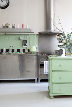 Stainless steel kitchen and celedon green cupboard.  published in Libelle magazine 2011  Photo Rene Gonkel, styling marit Saladini. www.libelle.nl