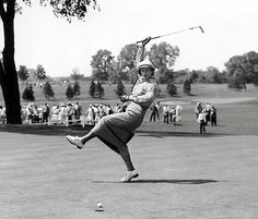 Aug. 4, 1950: Babe Didrikson Zaharias, displaying her playful side, urging the golf ball toward  the cup on the 18th green during the All Am...