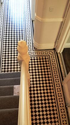 Victorian black & white chequer tiled floor in the hallway of a large terraced Victorian house in Cardiff which dated back to around 1900 was now looking well past its best.