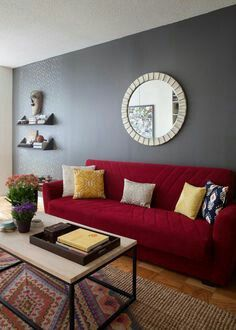 The intresting combination of grey and deep red giving a unique look to the living room