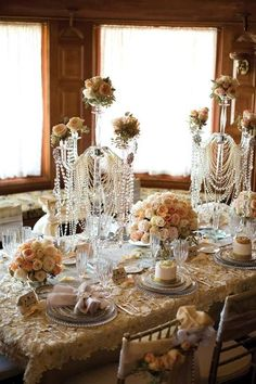 This is a gorgeous table idea! Except I would switch out the roses for big white feathers!