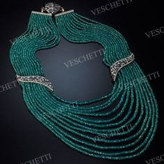 Demi set with cultured pearls, emeralds, sapphires and diamonds DEA