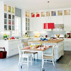 White kitchen with light color, some glass cabinets