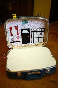 Another cute suitcase dollhouse with interchangeable room backgrounds.
