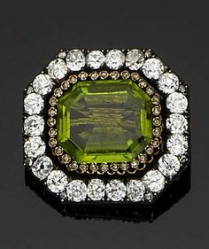 A late 19th century peridot and diamond brooch, circa 1890 The large octagonal step-cut peridot within borders of rose and old brilliant-cut diamonds, diamonds approximately 4.80 carats total, French assay mark, diameter 3.5cm., cased by Gustav Möllenborg, Stockholm