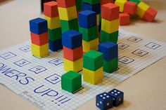 Towers up math game - the game as explained is a bit advanced for preschool, but I like the idea of stacking a certain number of blocks on top of (or next to) the numbers for one-to-one correspondence. Every little kid loves building towers!