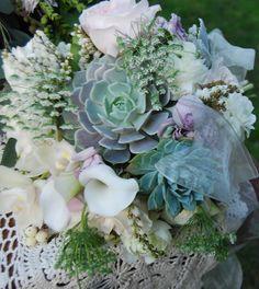 Bridal Bouquet, Succulents, Calla's, Ranunculas, Roses.
