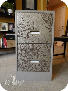 dress up a filing cabinet with wallpaper. can even paint the exterior a different color.