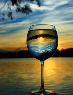 Evening reflects through wine.