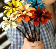 Barbed wire and tin roof flowers...love Merritt hyde's metal work...etsy