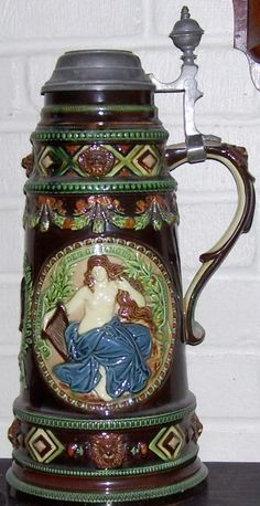 "Majolica steins – Very similar to ""Habnerware"" steins  in that they use a lead glaze and not tin. That makes for a much brighter surface. Shown: An Austrian 3 liter stein with classical Greek figures in relief. Circa 1880."