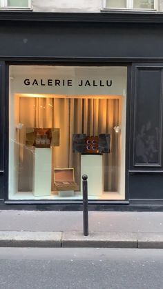 facade of Galerie Jallu with an exhibit of parchment coffers in the window. humidor, watch winder & whiskey box in parchment marquetry & gold plated brass, cigar box, meubles sur mesure, parchemin, collectible furniture, luxe, savoir faire, french artisan, yacht furniture design, furniture design, designed by Jallu, French design, furniture designers, furniture finishes, luxury finishes, luxury interiors, saint germain des pres, luxury presents