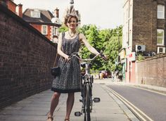 🔍 Check out this free photoWoman Wearing Grey Dress Standing While Holding Bicycle Near Roadside and Grey Brick Wall during Daytime    🆕 https://avopix.com/photo/37602-woman-wearing-grey-dress-standing-while-holding-bicycle-near-roadside-and-grey-brick-wall-during-daytime    #caucasian #sexy #person #fashion #attractive #avopix #free #photos #public #domain