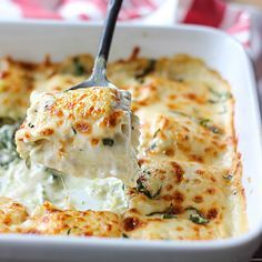 Delicious Ravioli Bake With Spinach And Artichoke Recipe Main Dishes with baby spinach, artichoke hearts, pesto, Alfredo sauce, vegetables, frozen ravioli, Italian cheese blend, butter, heavy cream, salt, pepper, parmesan cheese