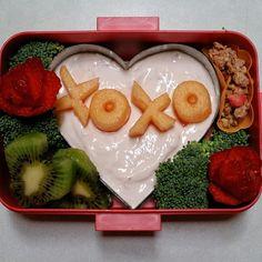 Andy's special valentine's day bento: strawberry yogurt, granola, kiwi hearts, strawberry roses, cantelope Xs and Os, and broccoli. #bento