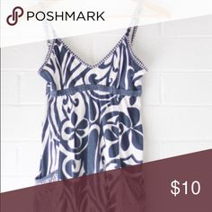 Hurley Top w/ Pockets Perfect for a cute + sexy look! Should cover your tush if you're under 5'6 :) Wear with shorts or skinny jeans for the perfect beach-girl look. Hurly Tops Tank Tops