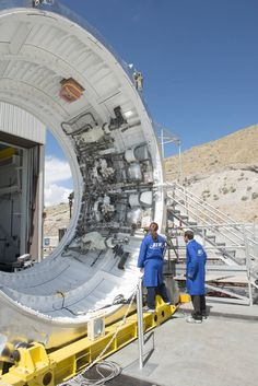 Space Launch System Images | NASA:  Systems Go for SLS Boosters Qualification Motor Test/Test technicians at ATK's facility in Promontory, Utah, examine the booster aft skirt, which is set up for final validation testing of its avionics command and control system.
