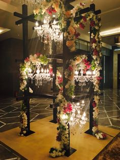 A multi level scaffolding with multiple chandeliers and exquisite flower work is the to do thing for your reception gala !!