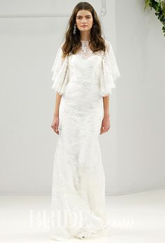 Brides.com: . Style F17-B08, Chantilly lace and silk crepe butterfly sleeve wedding dress with hand-embroidered lace flowers, French knots, rice pearls and crystals, Sachin & Babi