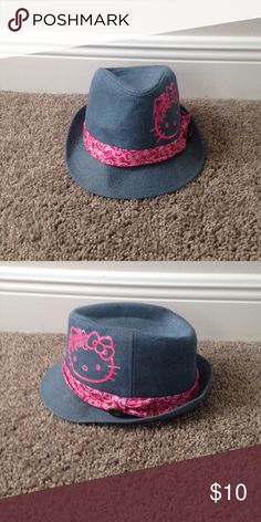Hello Kitty denim hat It is a hello kitty hat with a tie around it and it is denim Hello Kitty Accessories Hats