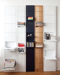 The flat units sit almost flush against the wall, looking like art pieces or even some new kind of tile. But when you need a shelf (or two or five), you simply pull down one of the flat surfaces to give your stuff a place to rest. The simple idea is gorgeously executed in a number of woods and finishes to let you find the one that fits perfectly with your existing decor