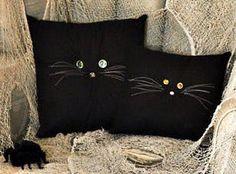 button-eyed-cat-pillow
