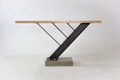 A custom table made of maple, steel, and concrete.  Donated to Montana State University for the Celebration of Architecture 2014.Steven Berkas, Zach George, Taylor Proctor.Good Design Collective 2014.