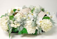 My Beverly Hills Florist presents this beautiful grouping of fifty white Orchids and other seasonal flowers and greens in a handsome wooden box.