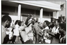 """Danny Lyon, """"The Soldier is greeted as hero. February 7, Port-au-Prince,"""" Silver gelatin print, Pomona College Collection (Claremont, CA)"""