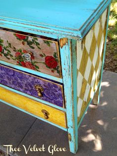This is a bold mix of colors and patterns. not sure about the top two drawers...turn the green diamonds on the side to yellow to match?