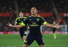 Alexis Sanchez celebrates after opening the scoring in the Premier League clash at St Mary's