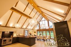 Three Sided Beam Covers - Oakmasters -  Three sided oak beam covers in a stunning contemporary kitchen diner