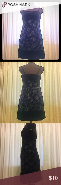 Black & Floral Velvet-like Spaghetti Strap Dress French Curve short spaghetti strap dress. 100% polyester, but looks and feels like like stretchable soft velvet. center of Dress is has stone gray purple roses on it. Very feminine, but fun & flirty. Gently used - worn only once for a dance. Perfect condition. Made in USA French Curve Dresses Mini