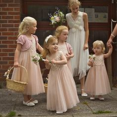 Pretty pastel pink flower girls at a traditional English Wedding Ceremony.