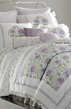 Such a feminine and relaxing bed collection. Love the mix of lavender, prints and ruffles.