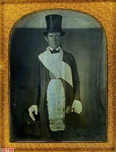 ca. 1850's, [daguerreotype portrait of a gentleman holding a book and gavel, wearing top hat, gloves and a Freemason apron and sash]  via the Daguerreian Society, Jon Lance Bacon Collection