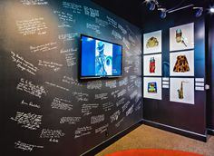 The exhibit features video and a wall of signatures and messages written by artists represented with photographs. Photo Exhibit, Memphis, Photographs, Messages, Display, Artists, Writing, The Originals, Wall