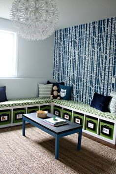 I love this contrast of color!  The white accented by the navy blue, the navy blue contrasting with the lime green and the nature element emphasized by the pillows and fabrics.  It is set off by the earth tones in this woven rug, almost a grass-wood outdoor look to it. Love this space!