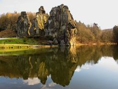 """Reflected Rocks"" - The Externsteine are a distinctive rock formation located in Ostwestfalen-Lippe of northwestern Germany, not far from the city of Detmold at Horn-Bad Meinberg. The formation is a tor consisting of several tall, narrow columns of rock which rise abruptly from the surrounding wooded hills. The name probably means ""stones of the Egge"", Egge meaning ridge."