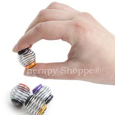 Super cool little springy, bouncy, squeezy, orb-shaped metal coils that strengthen fingers as you squish, squeeze, and pogo away; providing deep pressure input to your fingers! These neat pincer and tripod grasp-building, pocket-sized sensory fidgets are perfect for anxiety and stress relief, keeping restless fingers busy, and for promoting/building finger grasps. Springy Coil Fidgets™ are a great choice for children, teens, and adults who struggle with BFRBs.