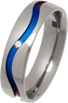 Looking for a wedding ring with some colour?  Look no further!!  Titanium Blue Wave Ring with Single Diamond £215