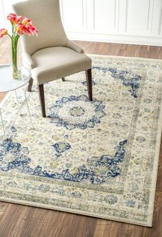 Full of vibrant vintage detail and lovely pastel color with this Bosphorus BD07 Rug. Check out that navy blue, faded grey, and hints of yellow on Rugs USA!