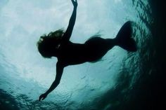 Silhouette of a Mermaid in the water